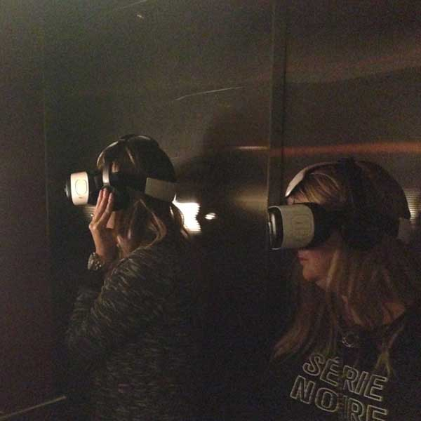 People wearing a virtual reality headset in the middle of an experience